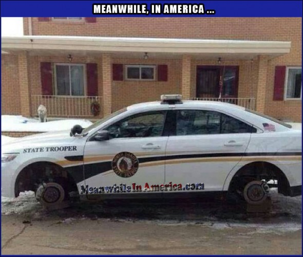 cop car on blocks stolen wheels Meanwhile In America